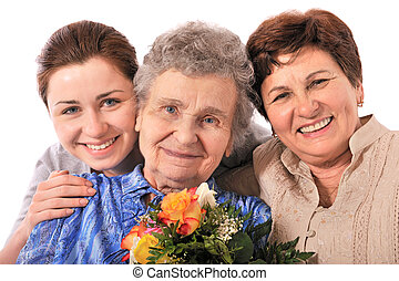 grandmother receives a bunch of flower from her family