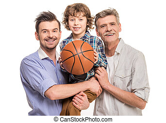 Generation portrait. Grandfather, father and son, isolated a white background. Boy holding in hands ball.