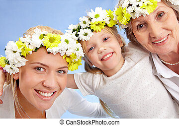 Portrait of grandmother with adult daughter and grandchild with diadems