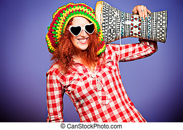 generation - Portrait of a rastafarian girl playing her...