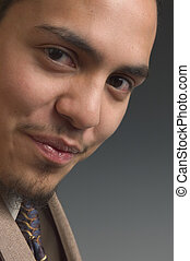 Generation X - close up of a young hispanic male smiling