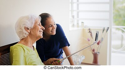 Generations Gap Happy Old Woman And Granddaughter Taking Selfie