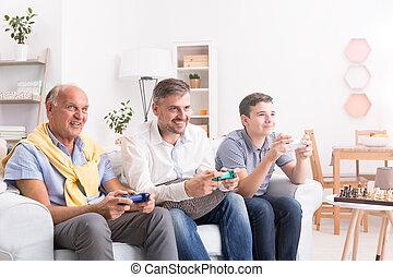 Generations of men playing game
