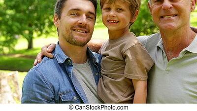 Generations of men smiling at camera