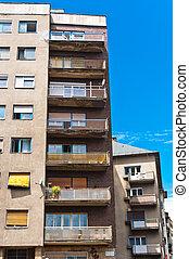 Generic apartment building in Europe against blue sky