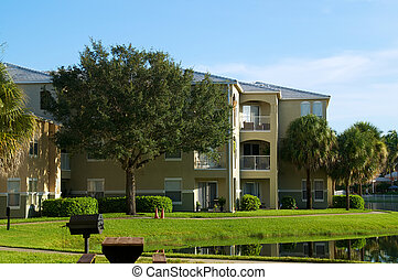 generic apartment building in florida - Looking across pond ...