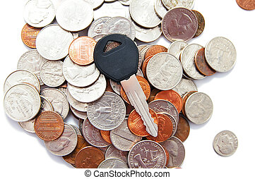 generic car key on a pile of coins