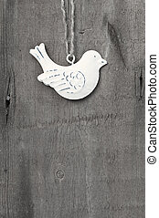 Generic machine made Christmas bird ornament on rustic style bac