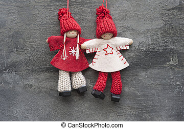 Christmas peg dolly ornament on rustic style grunge background