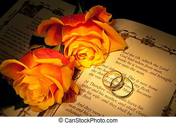 Genesis and wedding rings - Two wedding rings and roses on a...
