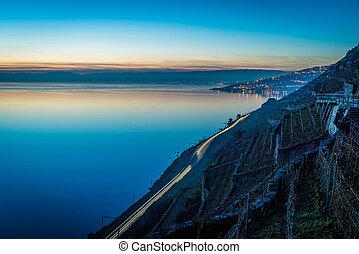 Geneva lake at night with vineyards