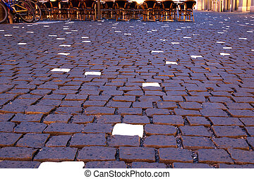 Geneva, Switzerland, one of the city streets at night with glowing paving bricks (pavers)