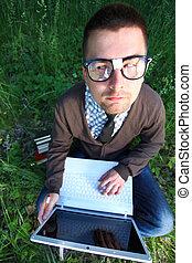 Genius nerd - Nerd man outdoor with funny face in glasses