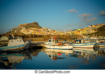 SARDINIA, ITALY - AGOUST 13: Touristic port of Castelsardo on August, 10 2013. the touristic port of Castelsardo, Sardinia, It is located at the foot of the medieval village Castelsardo, striking and characteristic city of Sardinia.