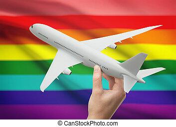 gens, -, main, lgbt, drapeau, fond, avion