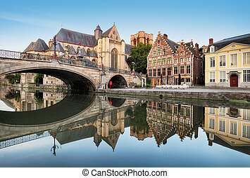 Gent - Medieval cathedral and bridge over a canal in Ghent, Belgium