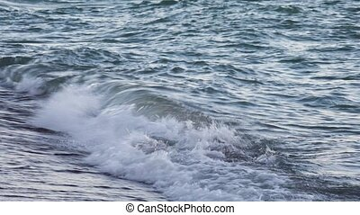Gentle Breakers Loop - Looping footage features small waves...