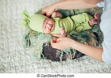 gentle hands mother. child falls asleep