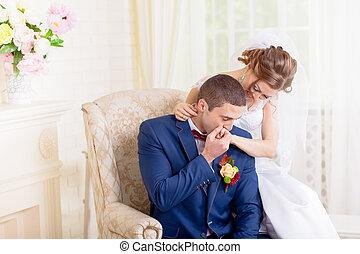 Gentle hugs and kisses the bride groom