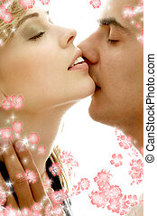 gentle kiss with flowers - intimate color image of sensual...