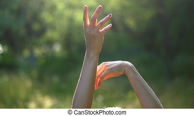Gentle Movements of the Hands of a Young Girl on the Background of Nature.