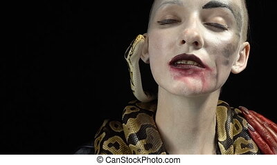 Gentle snake and woman in image - Footage of horror woman...