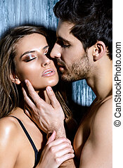 gentle touch - Close-up portrait of a passionate young...