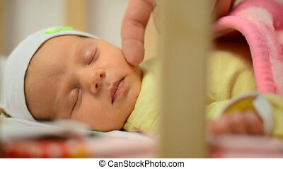 Gentle Touching Cheek of Newborn Baby, Close-up, Sleep Time