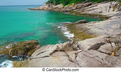 """""""Gentle Waves against a Rocky Tropical Beachline, with..."""