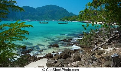 Gentle Waves along a Rocky Portion of Tropical Beach -...