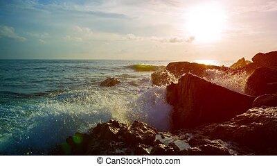 Gentle Waves of a Tropical Sea Splashing over Rocks