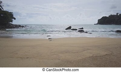 Gentle Waves on a Pristine Tropical Beach in Thailand - ...