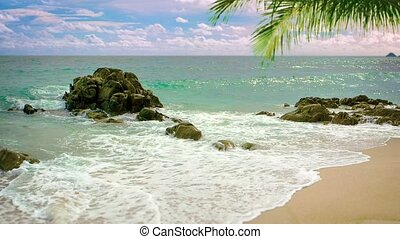 Gentle Waves Wash Over a Rocky, Tropical Beach
