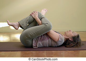 Gentle Yoga 1 - Middle aged female in a yoga pose.