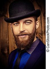 gentleman - Elegant man with beard and mustache wearing suit...