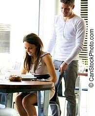 Gentleman Helping Girlfriend to Her Seat - Portrait of a...