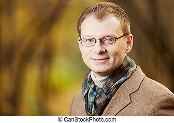 Gentleman - Portrait of elegant young man wearing coat and...