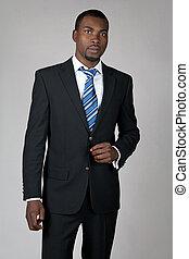 Elegant African American gentleman wearing suit and tie.