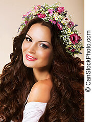 Genuine Young Woman with Flowing Healthy Hairs and Wreath of Flowers