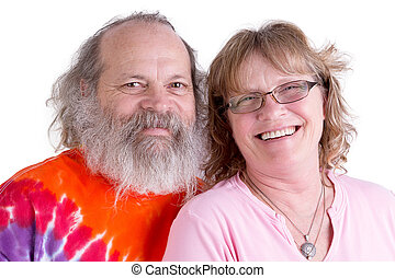 Genuinly Happy Baby Boomer Couple Looking at you Smiling -...