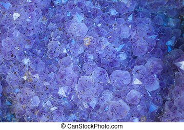 Geode Crystals - A background filled with purple and blue...