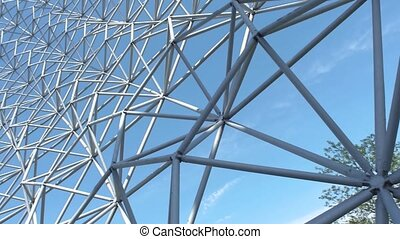 Low to high shot view of geodesic dome with a pan shot, under a clear and cloudy sky day surrounded with fresh trees