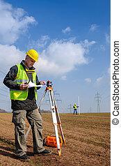 Geodesist measure land look construction plan - Land ...