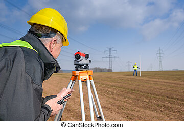 Geodesist measure land speak transmitter - Land surveyors ...
