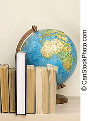 Geographic globe and books on the table
