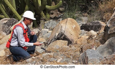 Geologist Man Loupe - Male geologist or prospector picks up...