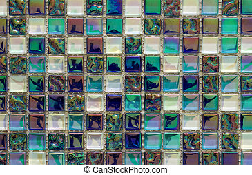 Geometric blue, purple and green mosaic tiles pattern. Wallpaper texture background. Small pieces tiles for construction and renovation works, decorative material for cowering walls and floor.