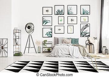 Geometric carpet in monochromatic bedroom