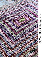 Geometric crochet on bed