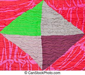 geometric ornament of silk patchwork quilt